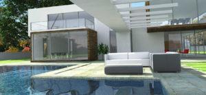 Casa Moderan de estructura cuadrada con paredes de vidrio piscina delante y sofá exterior blanco